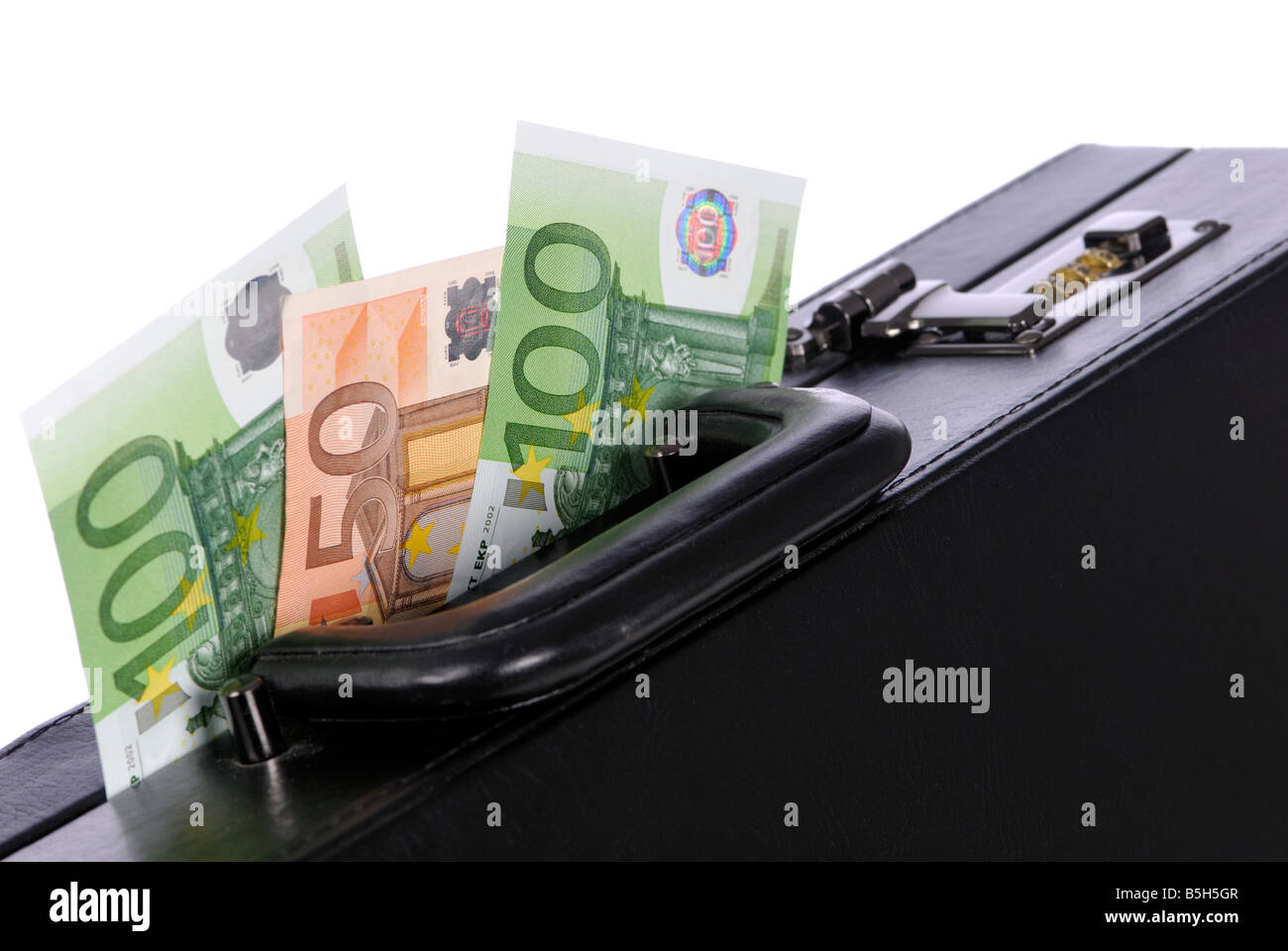 bank notes and a black briefcase - Stock Image