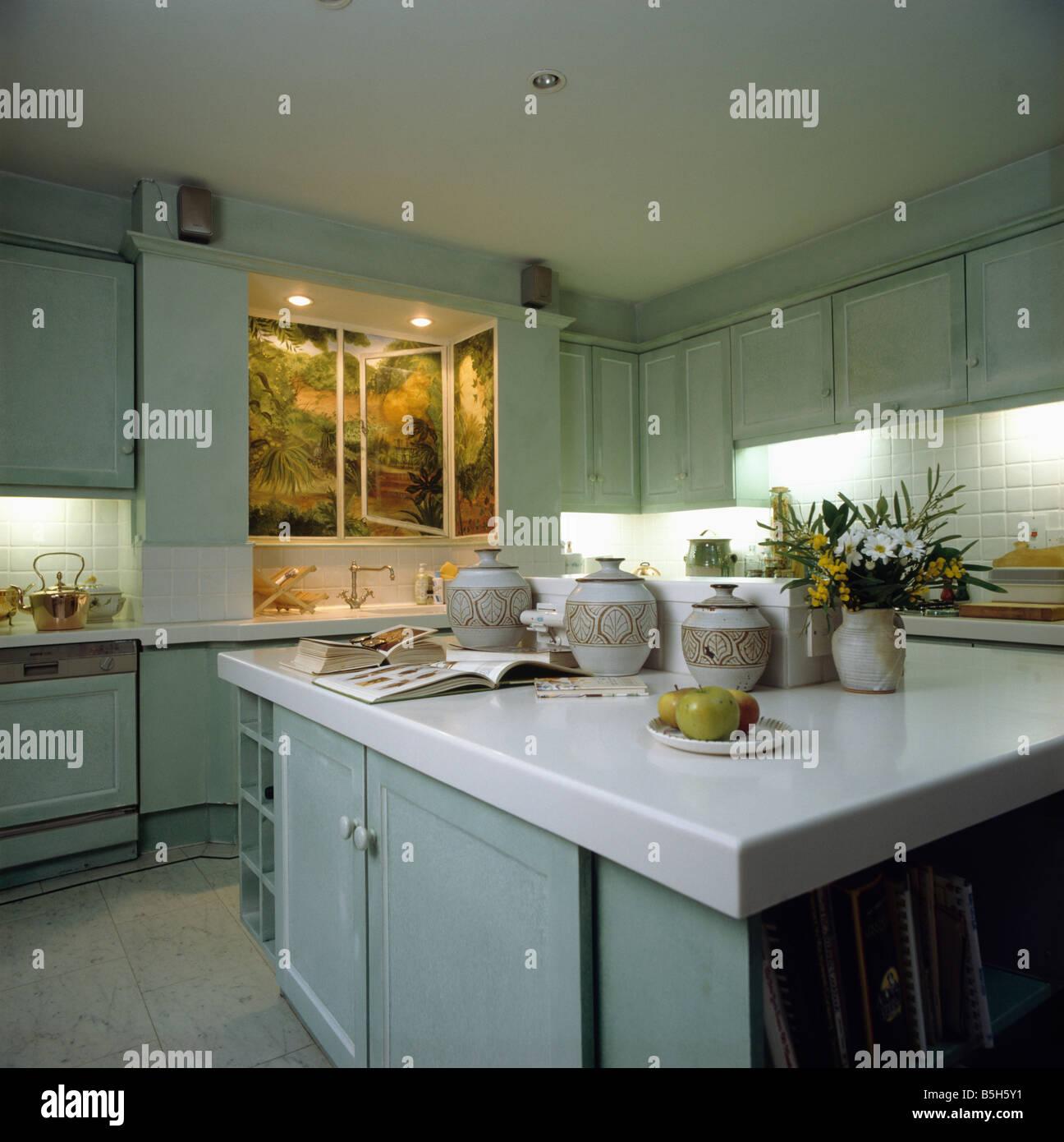 Lighted trompe l\'oeil landscape above sink in modern pale ...
