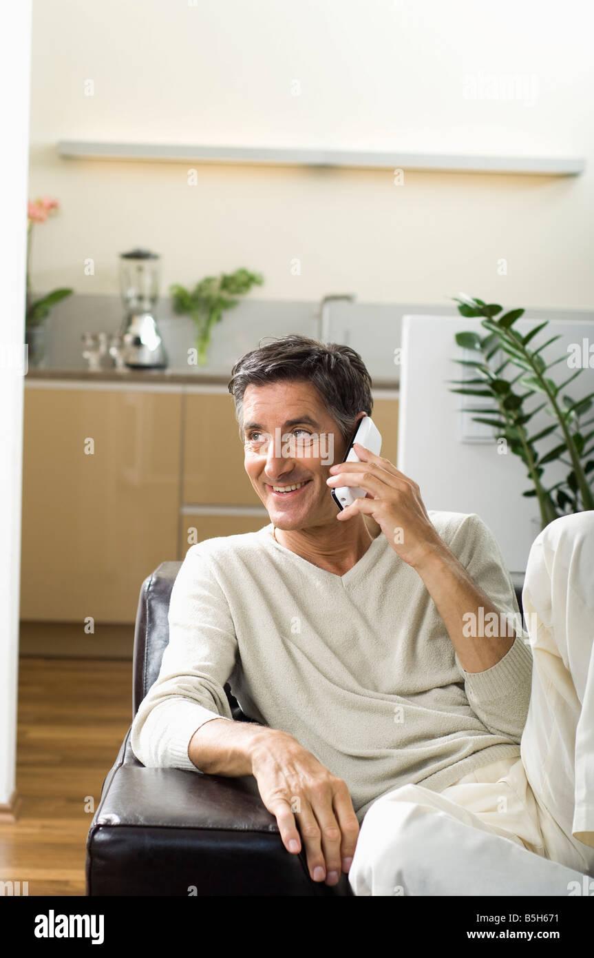 Mature man using a phone - Stock Image