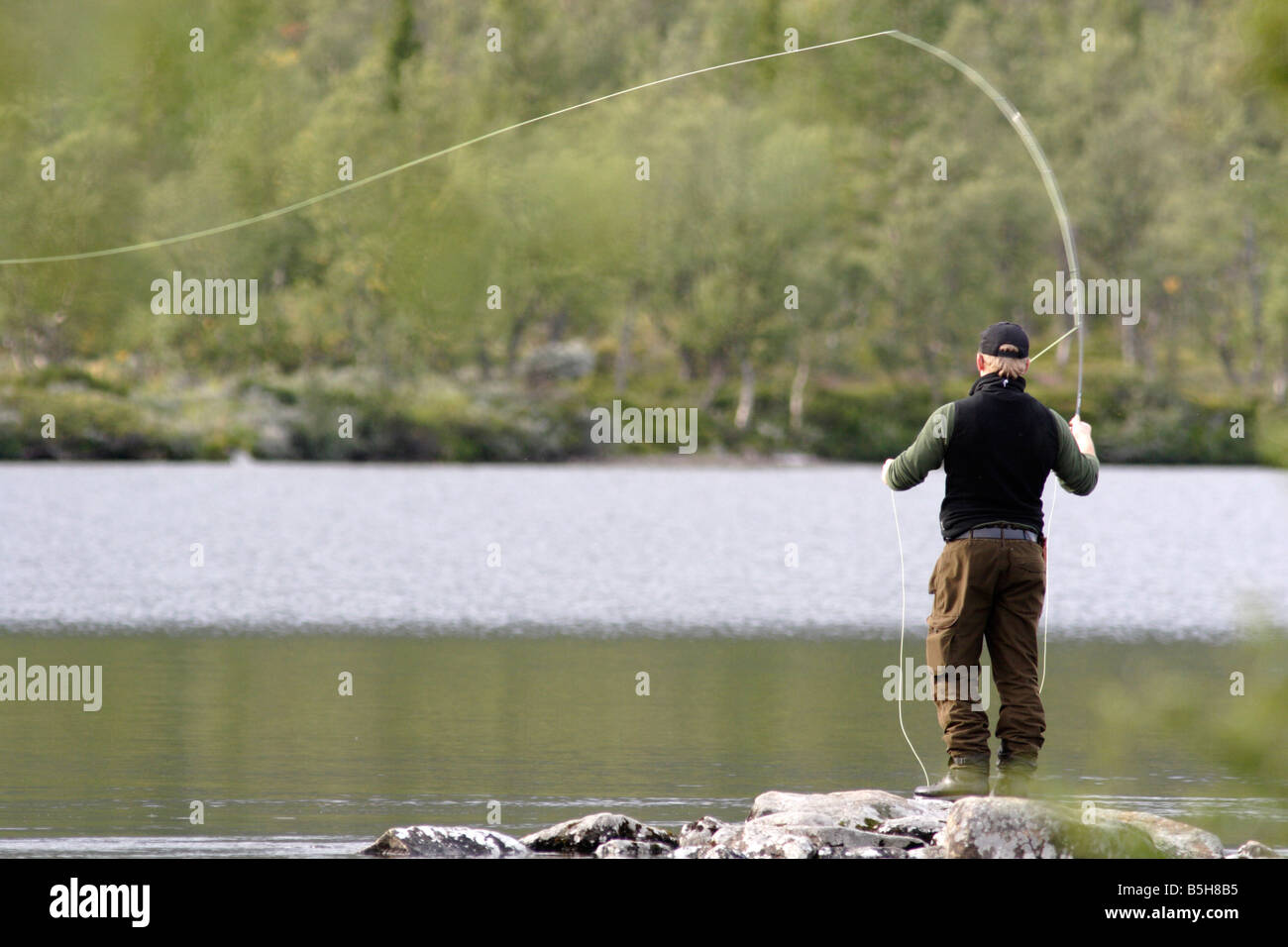 Fly fishing in Sweden. This was taken at Grövelsjön in Dalarna. - Stock Image