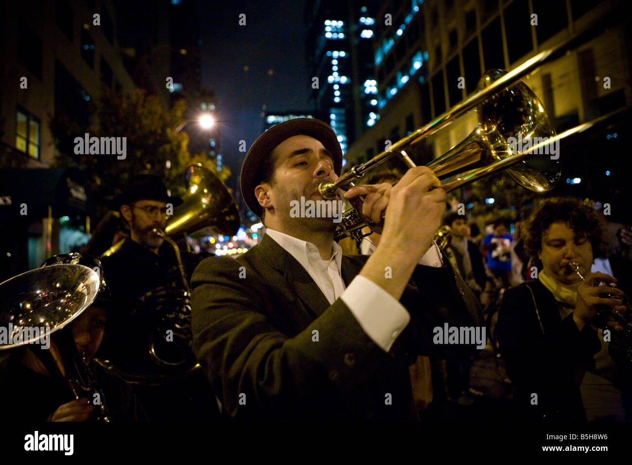 Seattle, 04.11. 2008. People dance as Balkan brass band play on the 1ST Ave. in Seattle on the night of Barack Obama's - Stock Image