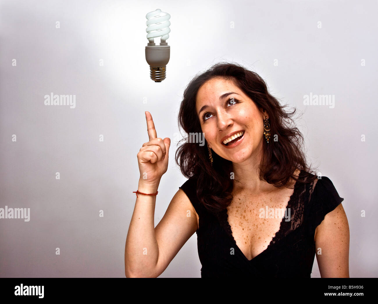 Woman having an environmentally brilliant idea - Stock Image