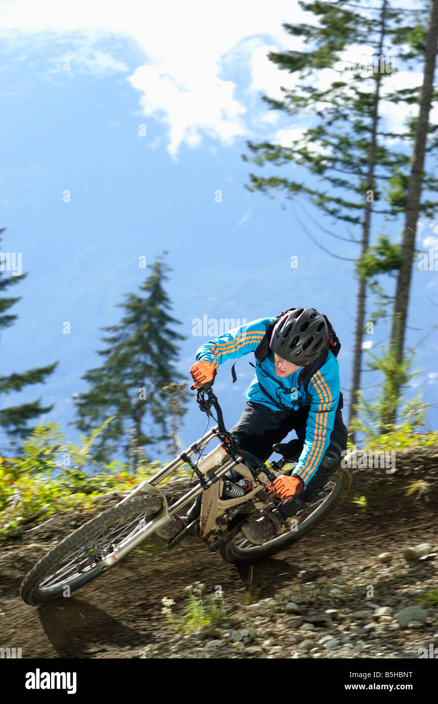 Downhill rider driving a curve - Stock Image