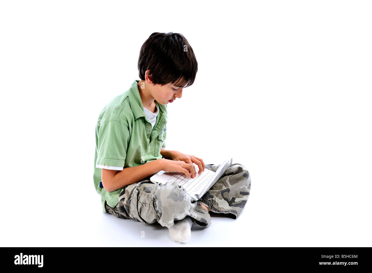 Young boy using an ASUS Eee PC laptop - Stock Image
