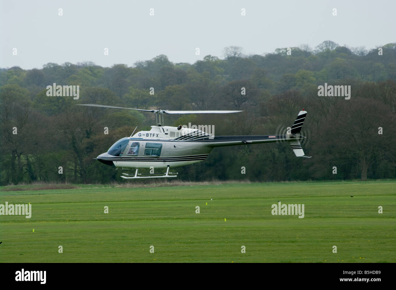 Bell Jet Ranger 11 G BTFX Helicopter in Flight Hovering Redhill Aerodrome Surrey Uk Helicopters - Stock Image