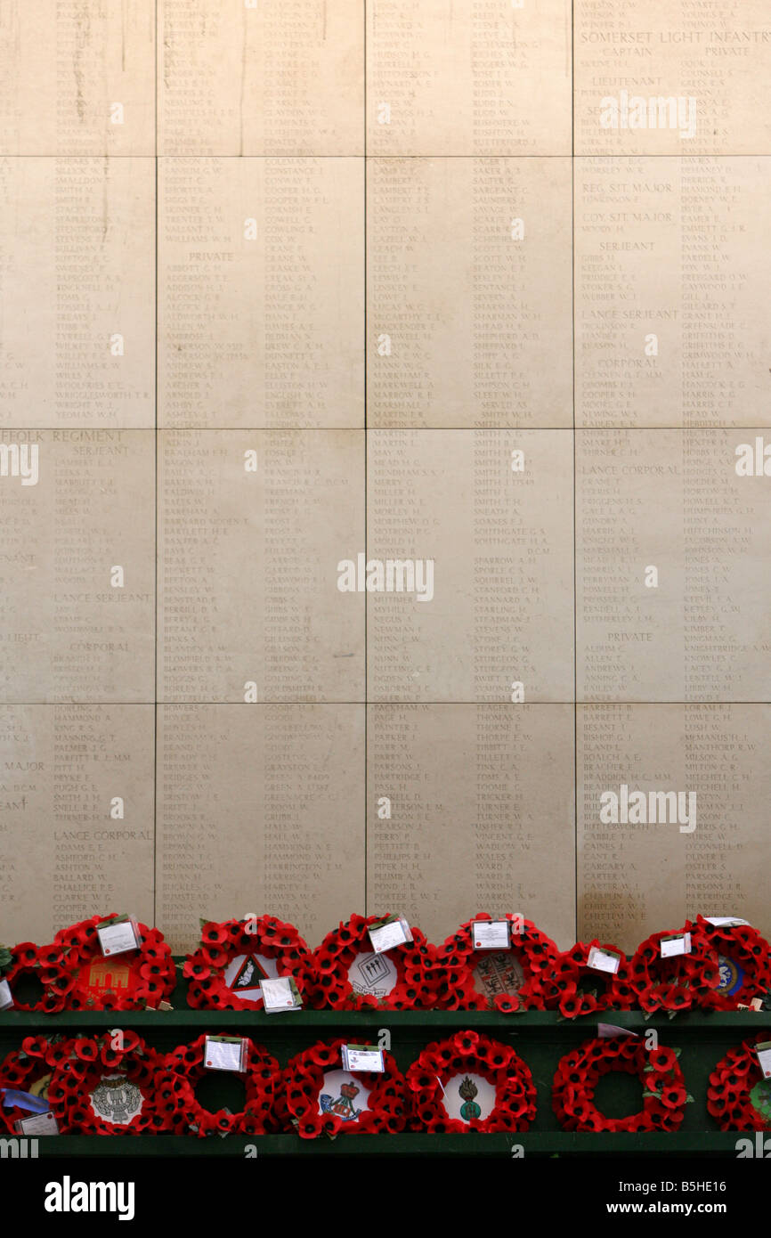 Poppy Wreaths below some of the names of the missing on the walls of the Menin Gate, Ypres. - Stock Image