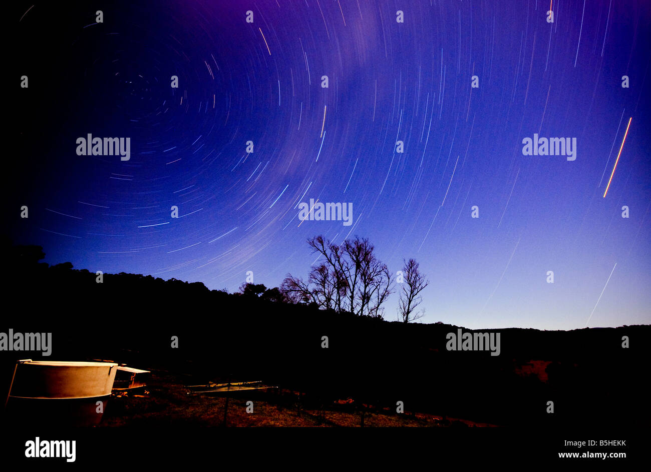 Night shot of star trails over the range at Towamba New South Wales Australia. Please note: includes some noise. - Stock Image
