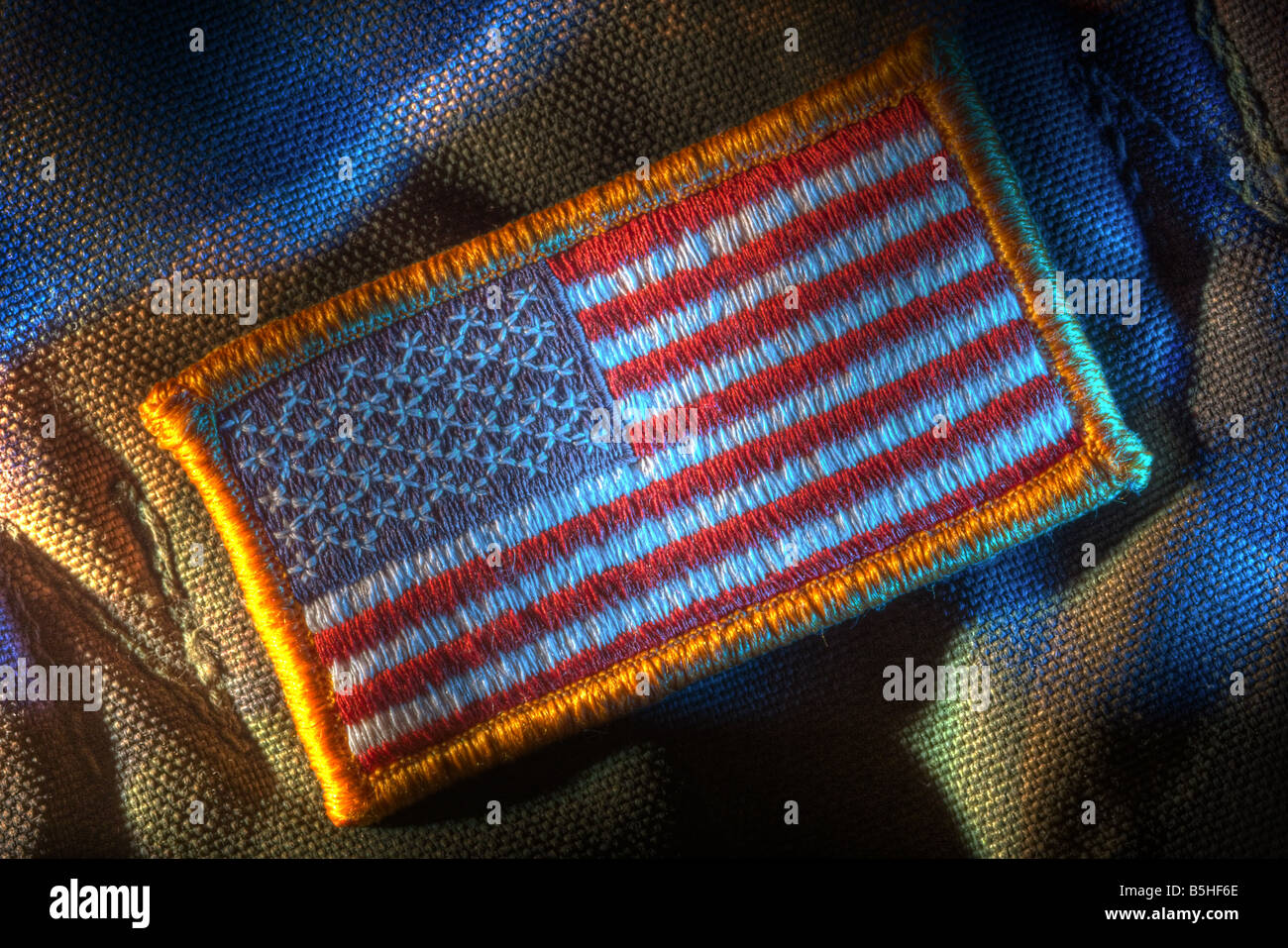 Detachable US flag patch on military camouflage fabricStock Photo