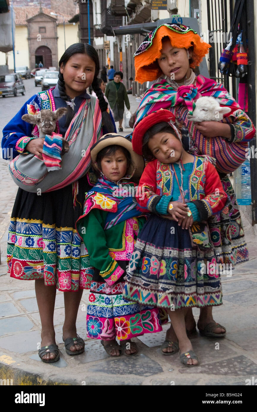 four peruvians girls in traditional dress on the streets