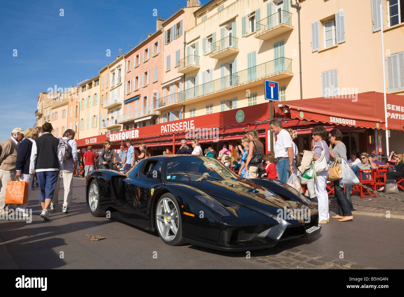 A Ferrari drives in Saint-Tropez at the Cote d'Azur / Provence / Southern France - Stock Image