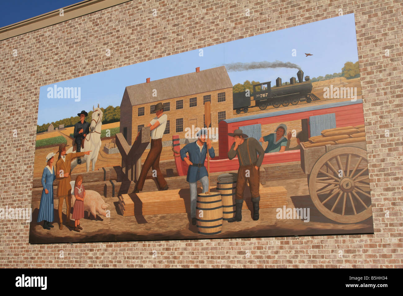 Painting of History Painting on a wall in St Marys Ohio depicting historic scenes Signed as Dan Keyes and Co October Stock Photo