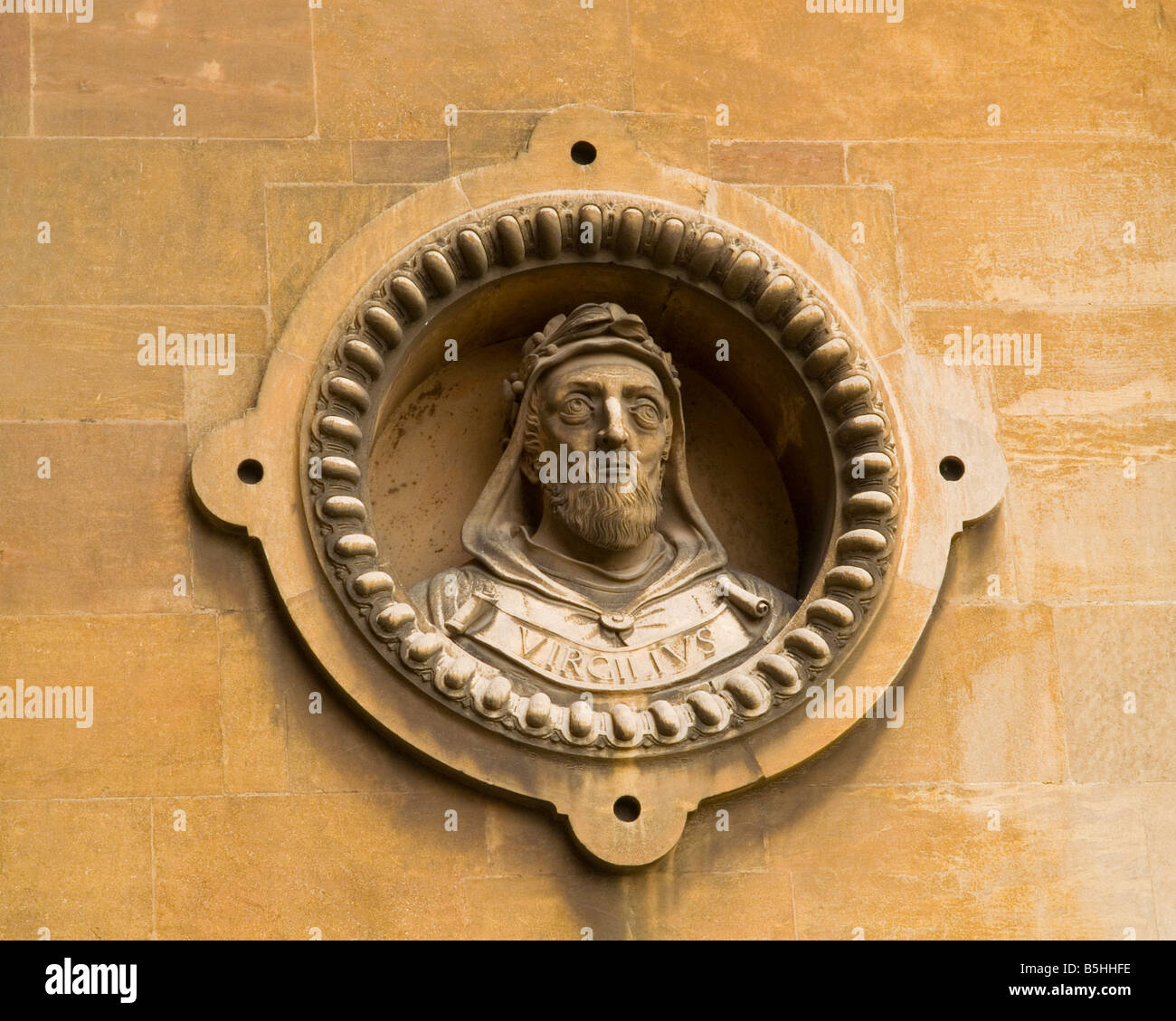 A stone statue carved into the exterior brick wall of Wollaton Hall in Nottingham, Nottinghamshire England UK - Stock Image