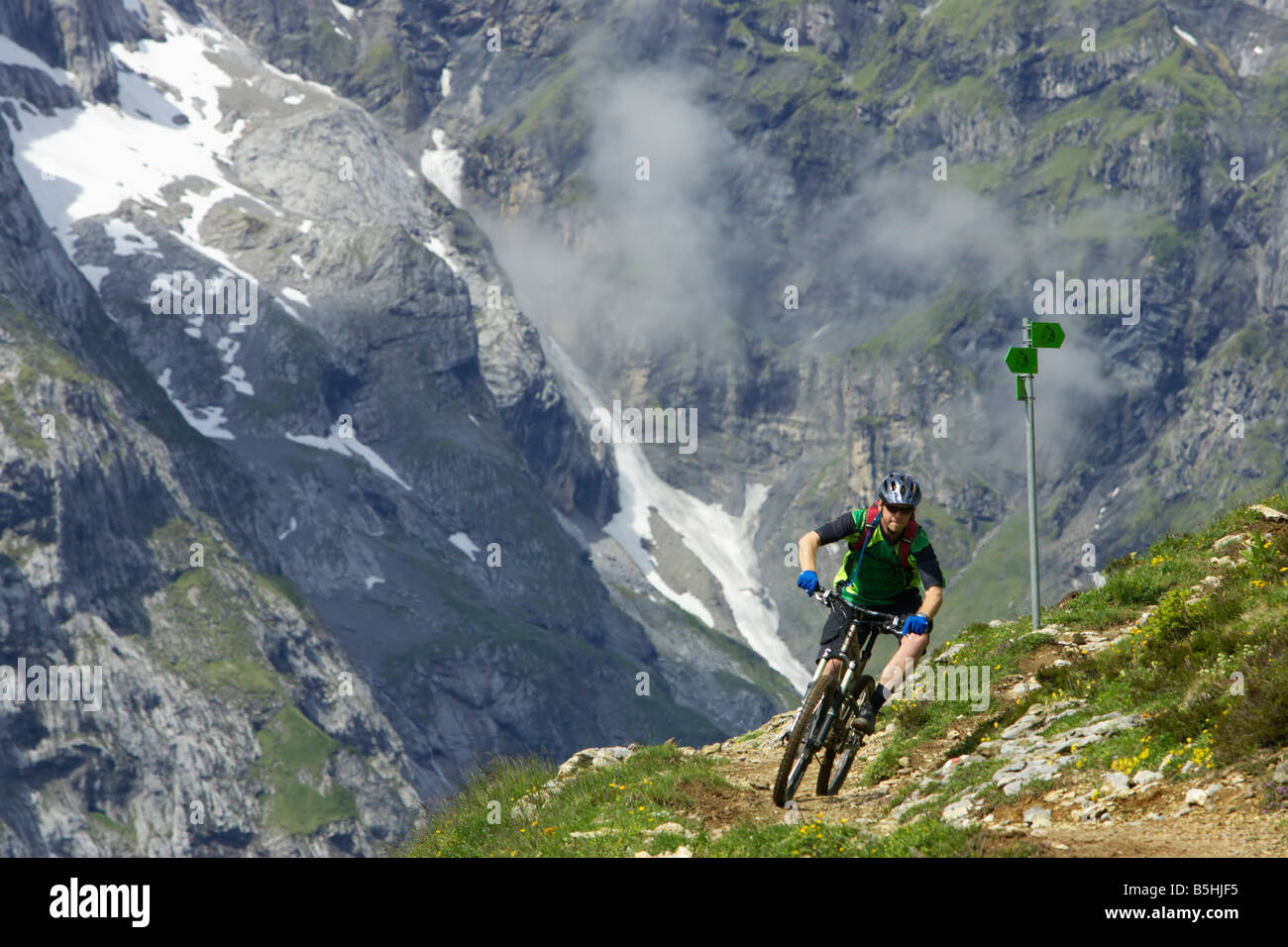 Bicyclist in the mountains - Stock Image