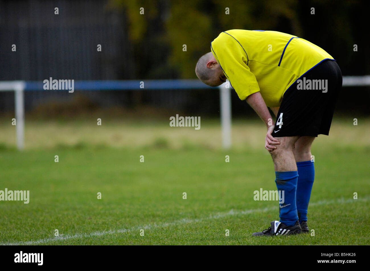 goalkeeper bends over in despair after his team has conceded a goal - Stock Image