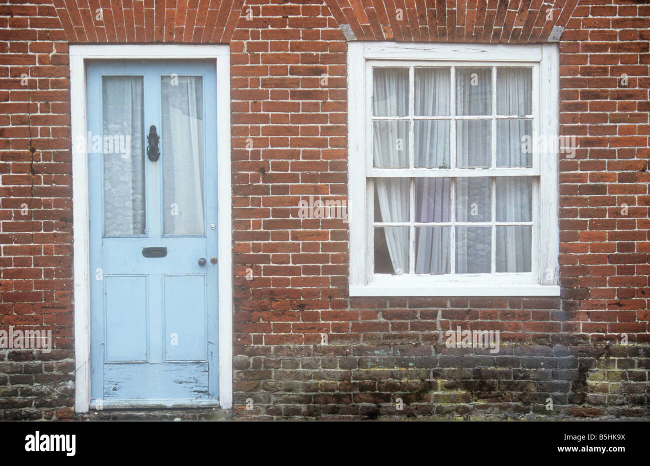 Once stylish pale blue wood and glass door and white sash window set once stylish pale blue wood and glass door and white sash window set in red brick wall of terrace house now needing repair planetlyrics Choice Image