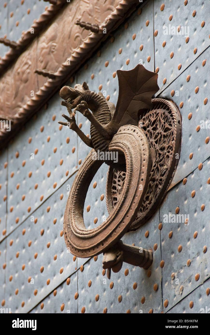 Gothic door knocker on the doorway of La Lonja de la Seda formally a commodity exchange in Valencia Spain Stock Photo