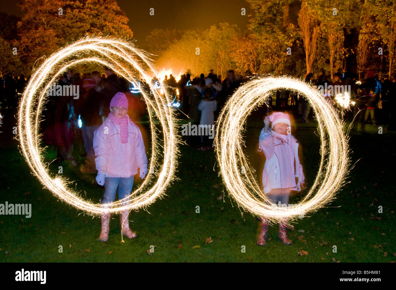 Two Young Children, Playing with Sparklers on Bonfire Night, Northwich, Cheshire, England, UK Stock Photo