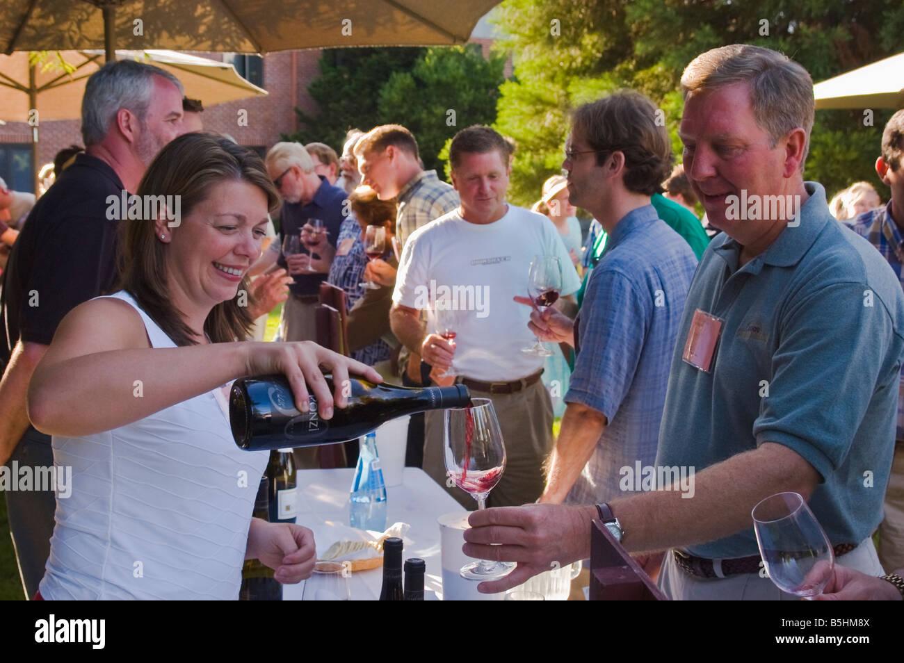 Winemaker Luisa Ponzi pours Ponzi Vineyards Pinot Noir International