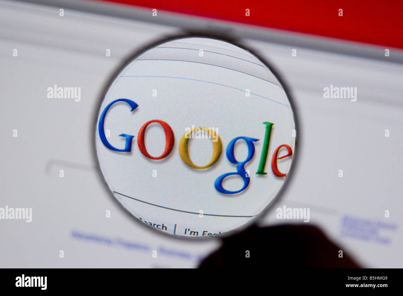 Google search engine Google logo on a computer screen with a magnifying glass. - Stock Image