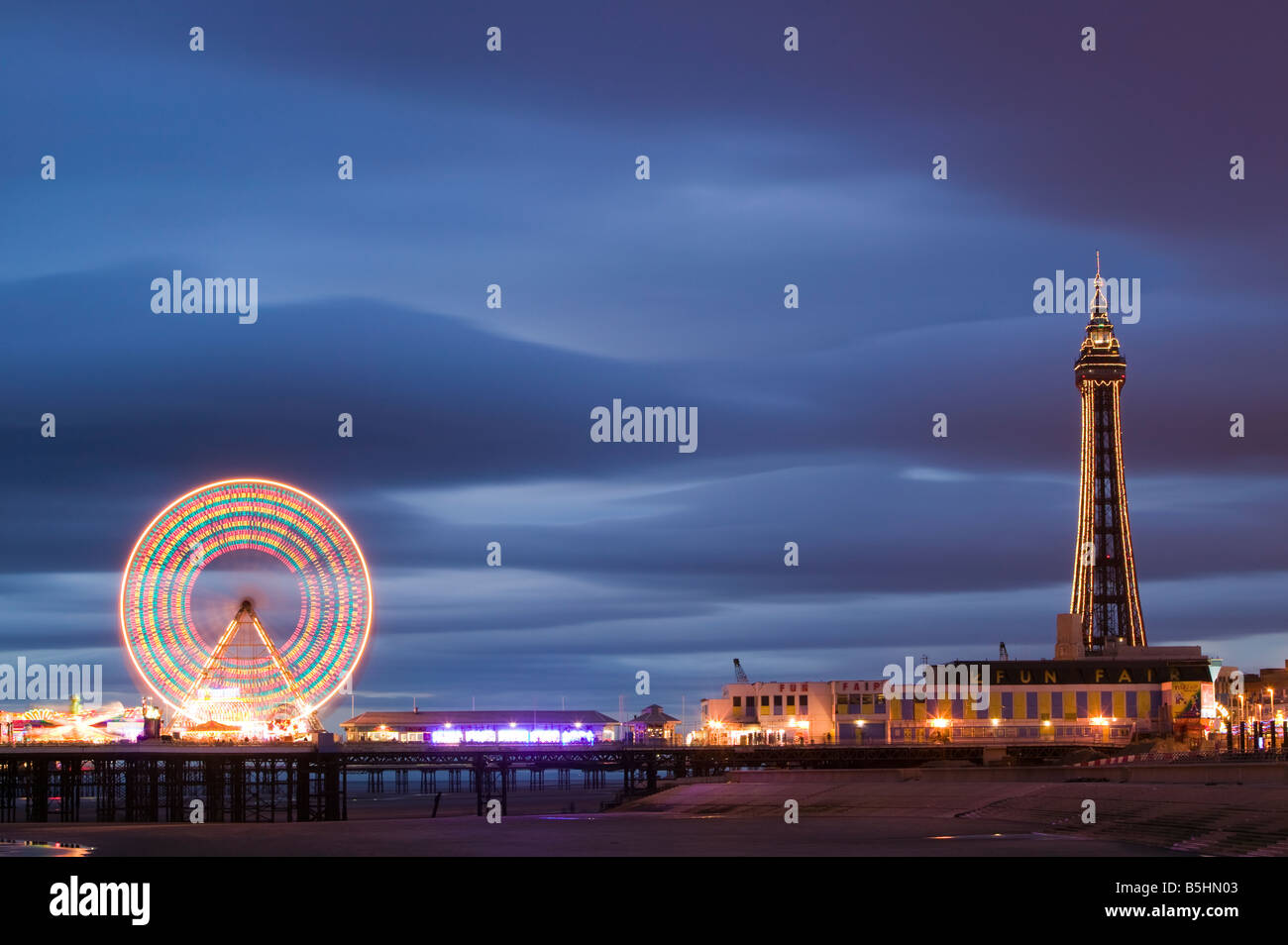 The Ferris Wheel on the Central Pier and the Blackpool Tower, Blackpool, Lancashire, England, UK. - Stock Image