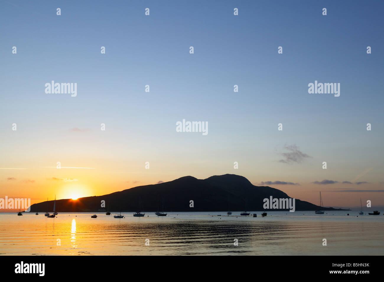 Holy Island off Isle of Arran, North Lanarkshire, Scotland, UK. Seen across Lamlash Bay at sunrise. - Stock Image