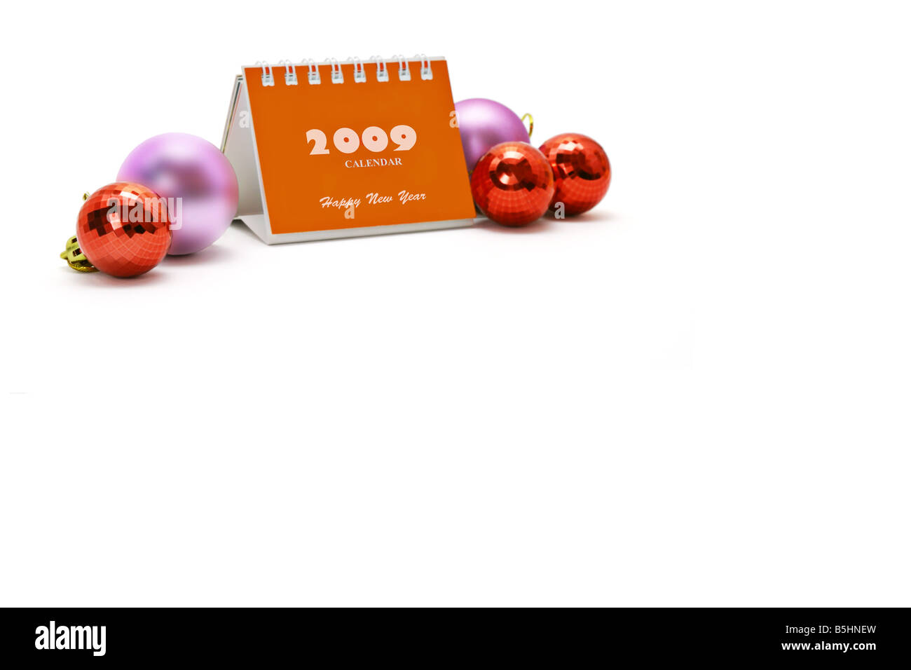 2009 desktop calendar and Christmas ornaments with copy space - Stock Image