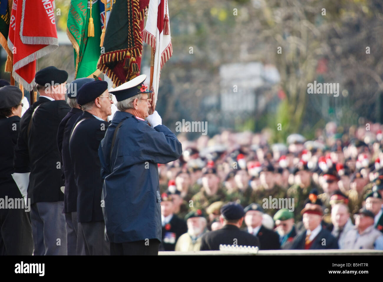 Veterans raise flags at Remembrance day service in Birmingham. - Stock Image