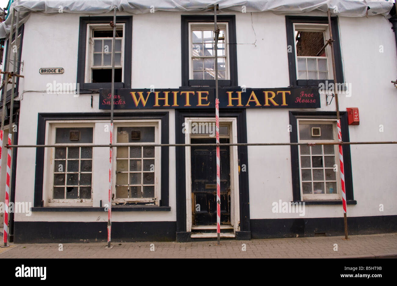 Exterior of White Hart pub being renovated in the rural market town of Usk Monmouthshire South Wales UK - Stock Image