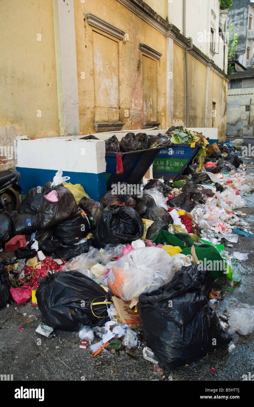 Overflowing rubbish bins - Stock Image