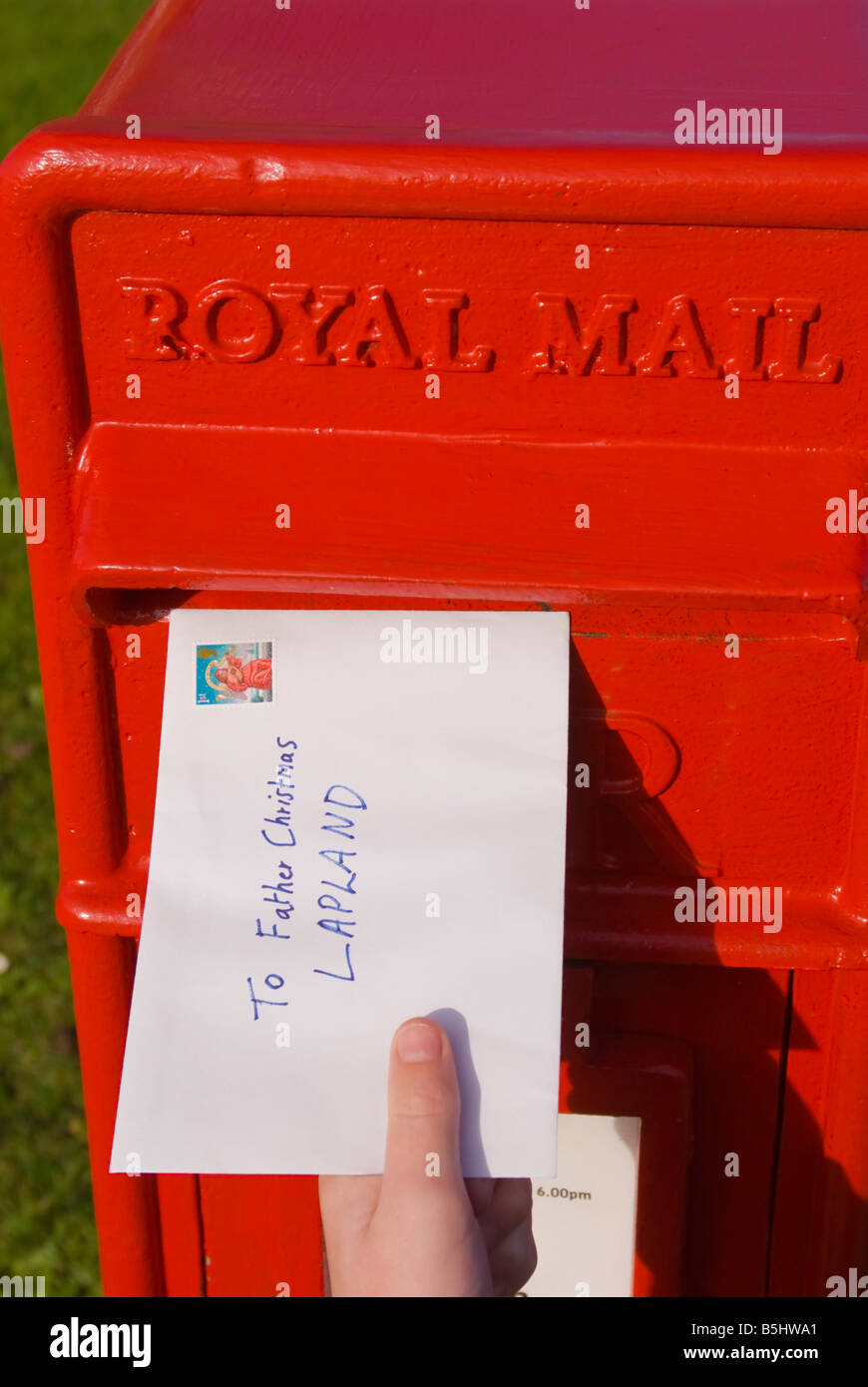 A letter being posted in uk royal mail postbox addressed to father a letter being posted in uk royal mail postbox addressed to father christmas lapland telling of childs christmas present list spiritdancerdesigns Images