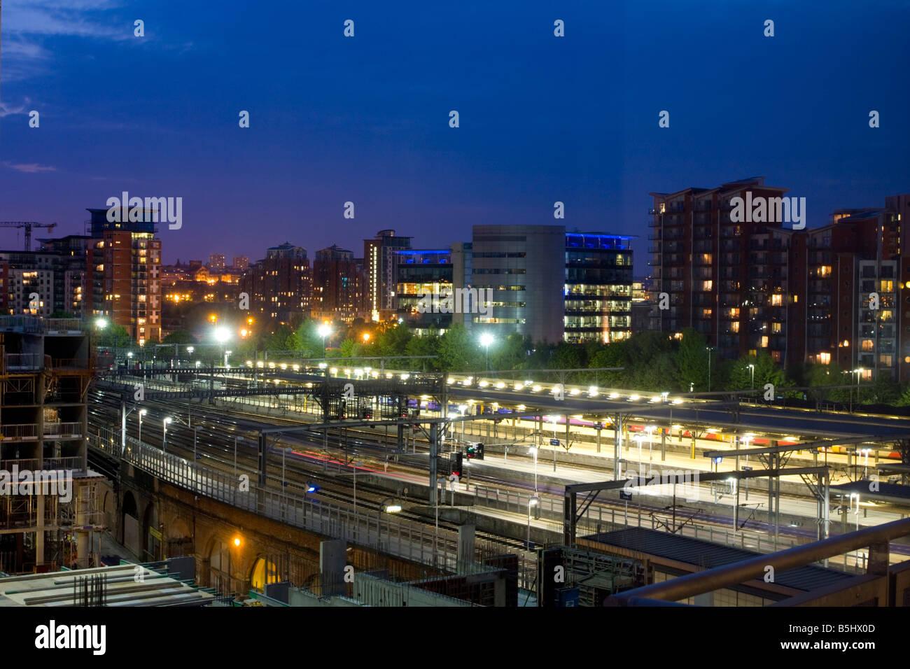Leeds city train station at dusk UK - Stock Image