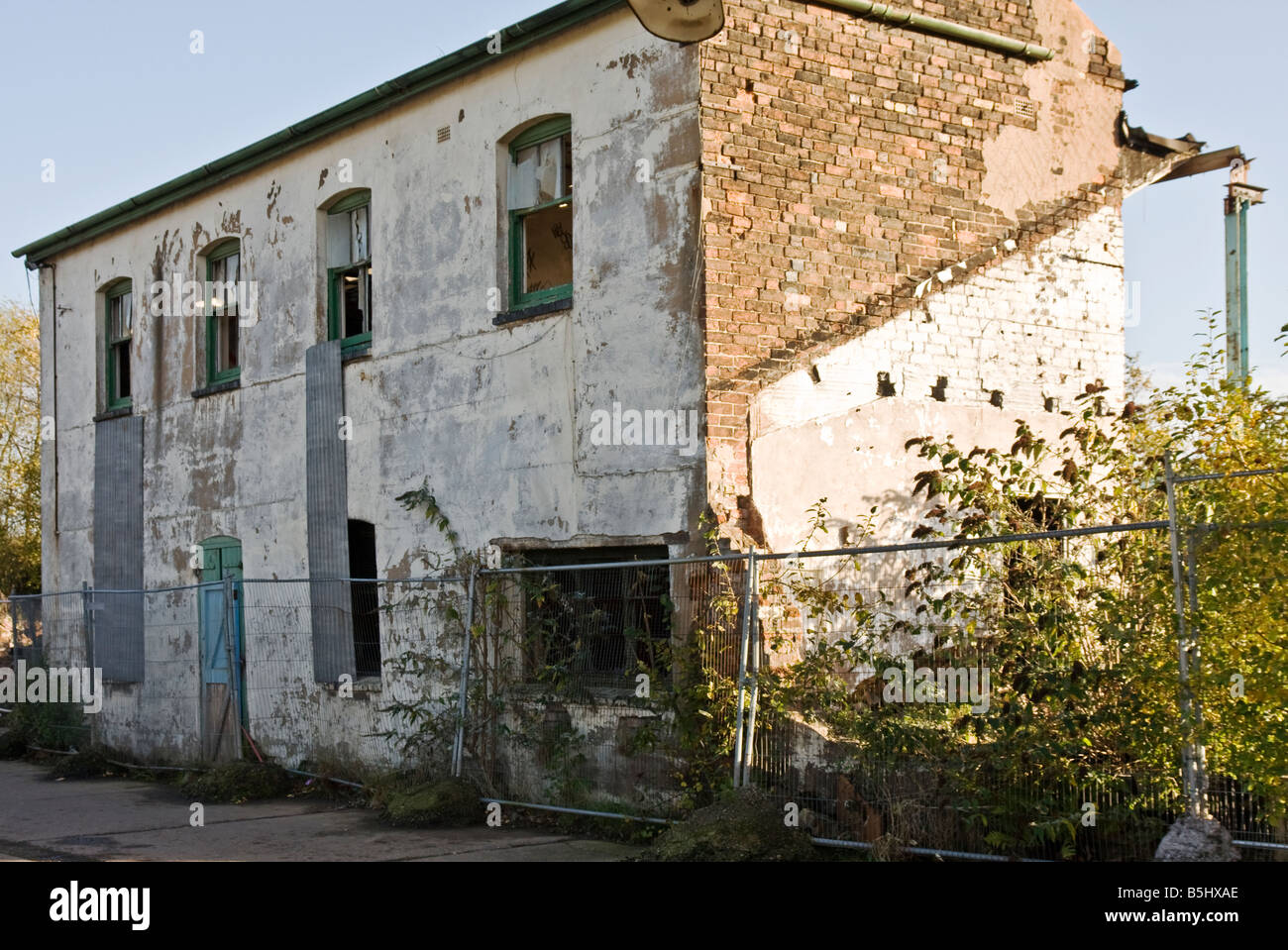 a dilapidated rundown disused old building - Stock Image