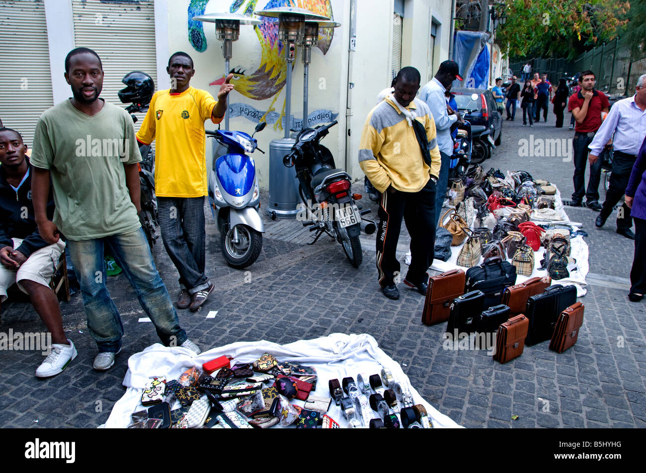 Athens Plaka shopping district underground clandestine immigrant immigration from Africa selling fashion bags Greek - Stock Image