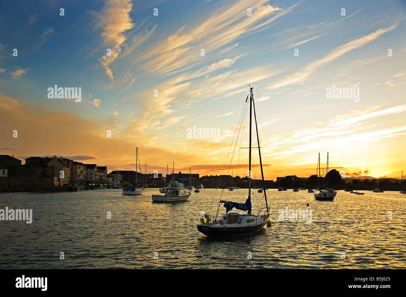 Dramatic Sunset over the Yachts in Dungarvan Harbour, The Mouth of the Colligan River, County Waterford, Ireland - Stock Image