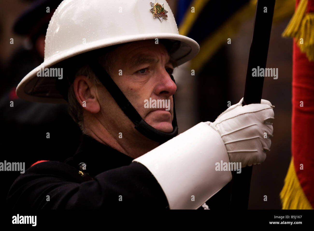 A member of the Grampian Fire and Rescue Service joins the 2008 Remembrance Ceremony in Sunderland - Stock Image