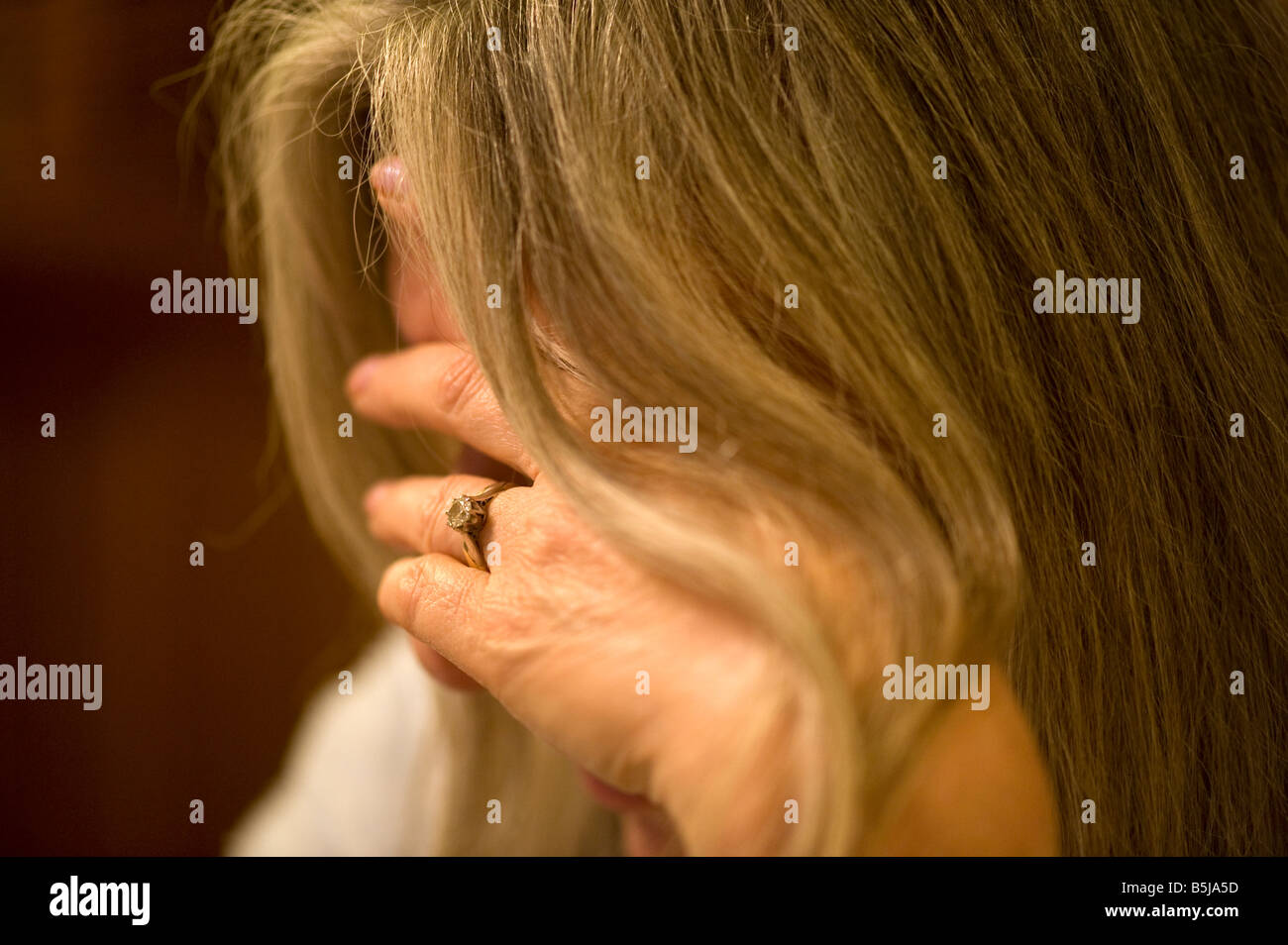 Depression A Depressed Woman in a restrictive focus image additionally Migraine or Headache - Stock Image