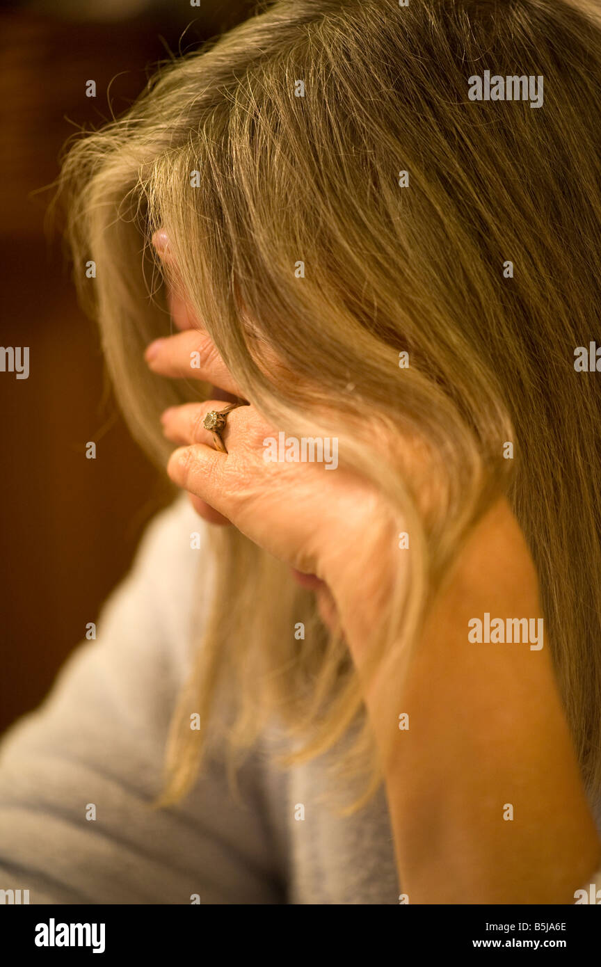 Depression A Depressed Woman in a restrictive focus image - Stock Image