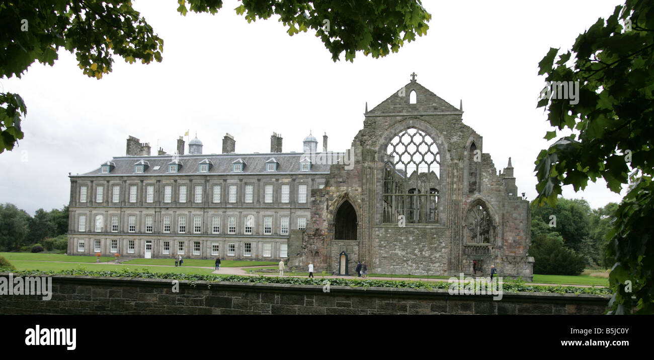 A general view of Holyrood Abbey ( Ruin) and Holyrood Palace, behind it in Holyrood Park Edinburgh - Stock Image