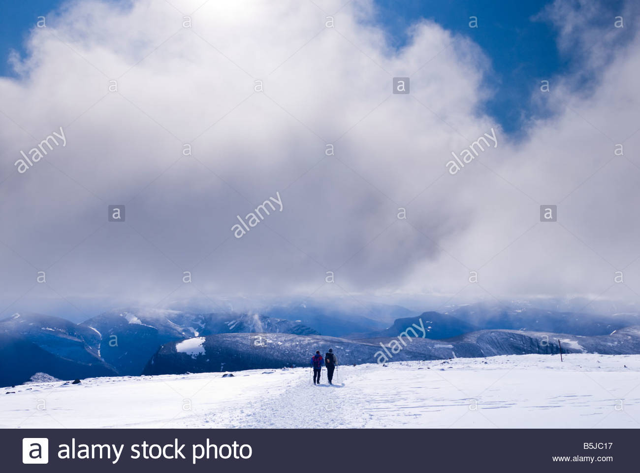 Two hikers descending from the summit of Kebnekaise, Sweden's highest mountain. - Stock Image