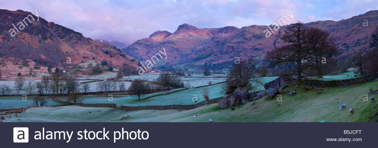 Panoramic view of the Langdale Pikes at sunrise, Langdale Valley, Lake District National Park, Cumbria, England, UK. Stock Photo
