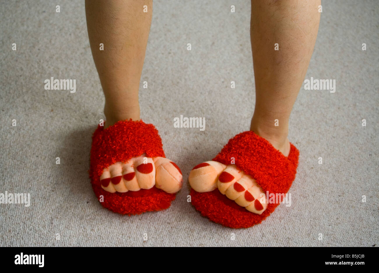 7b462e05055 Legs wearing red slippers Stock Photo  20688707 - Alamy