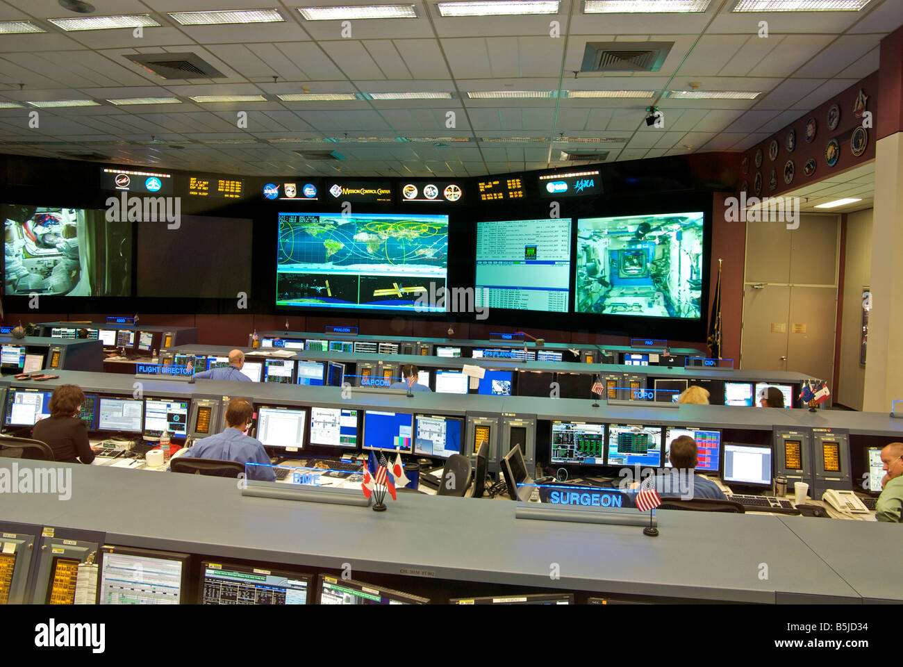 Controllers looking at computer screens working at new state of the art NASA Mission Control Center at the Johnson - Stock Image