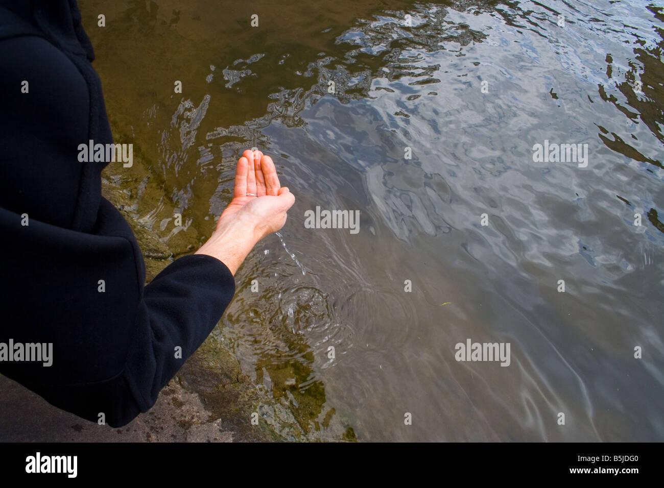 Man scooping the water Strasbourg june 2006 Stock Photo