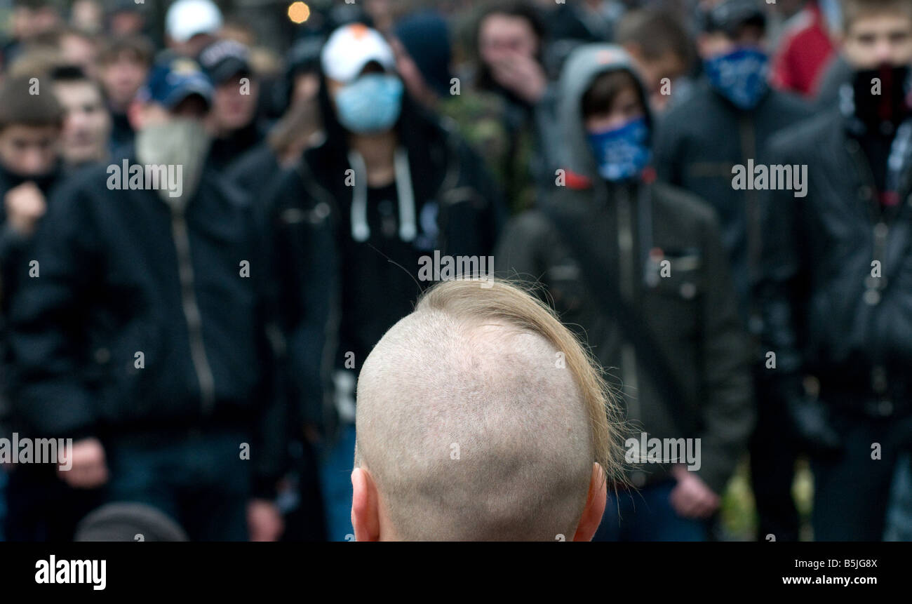 Ultra-nationalist activists hide their faces during their rally in central Petersburg on November 4. - Stock Image