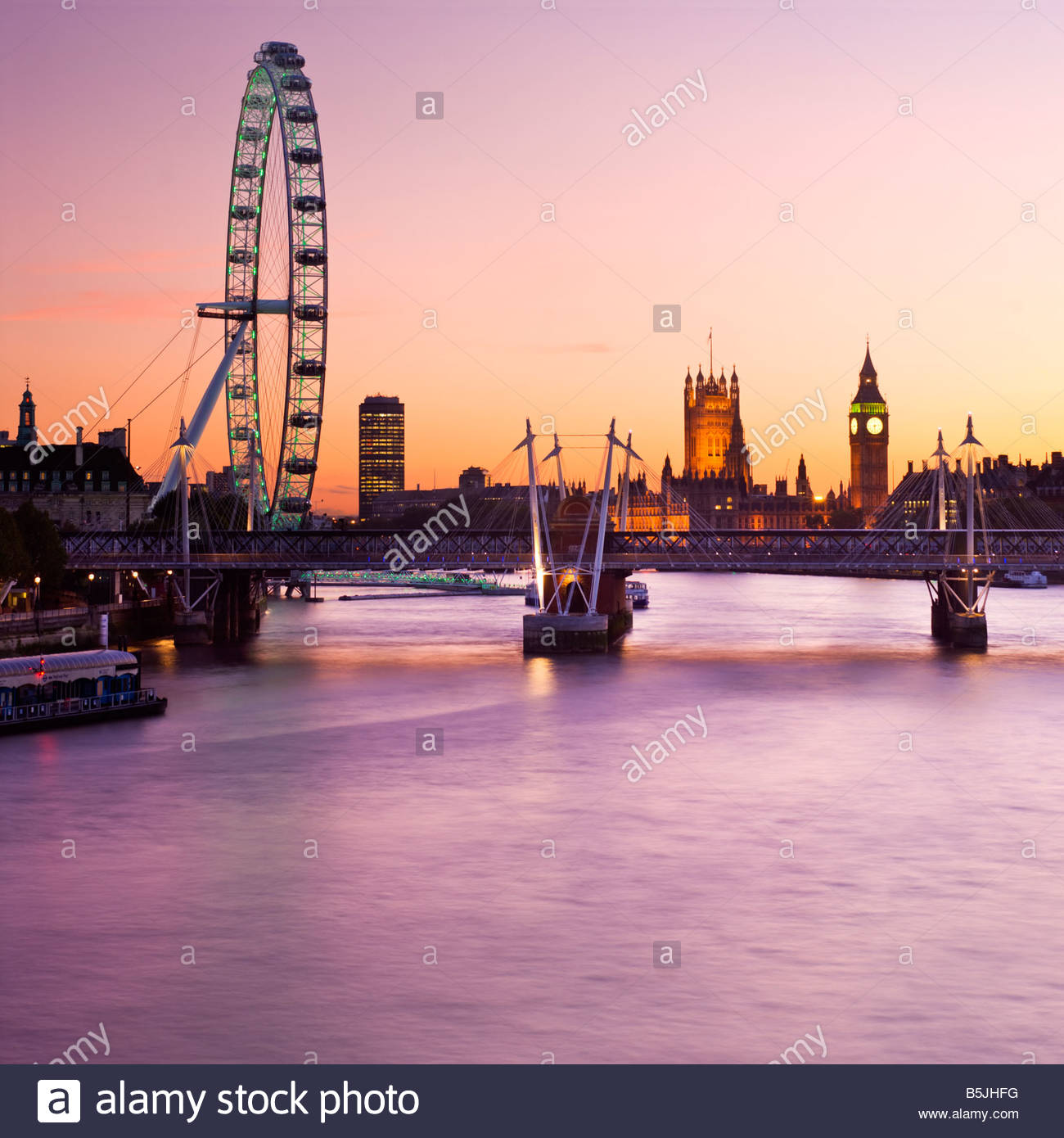 The London Eye and the Houses of Parliament, London, England. - Stock Image