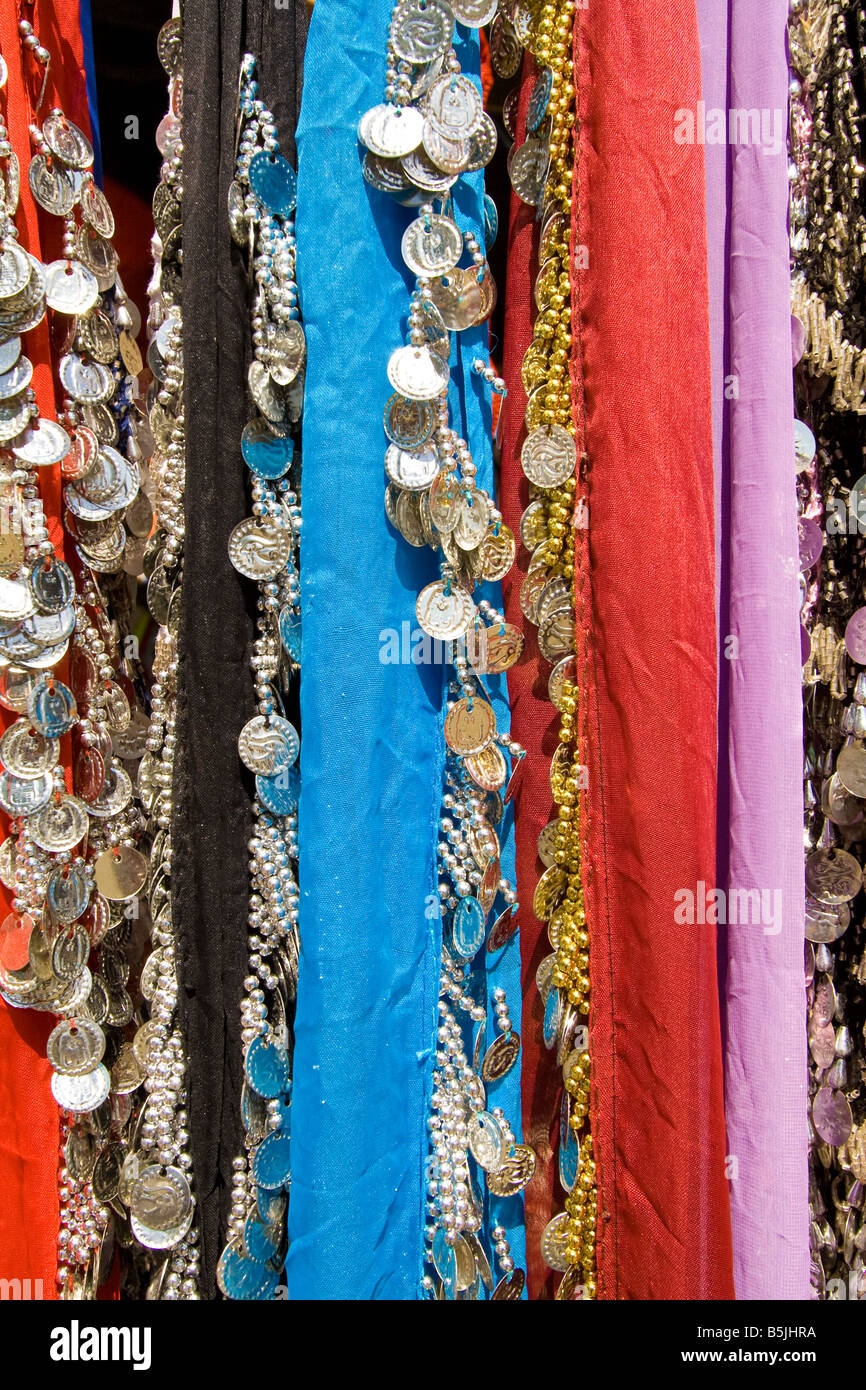 Detail of Belly Dancer skirts with shiny medals, at sale in the Re-enactment of a Renaissance Fair in Seixal, Portugal. - Stock Image