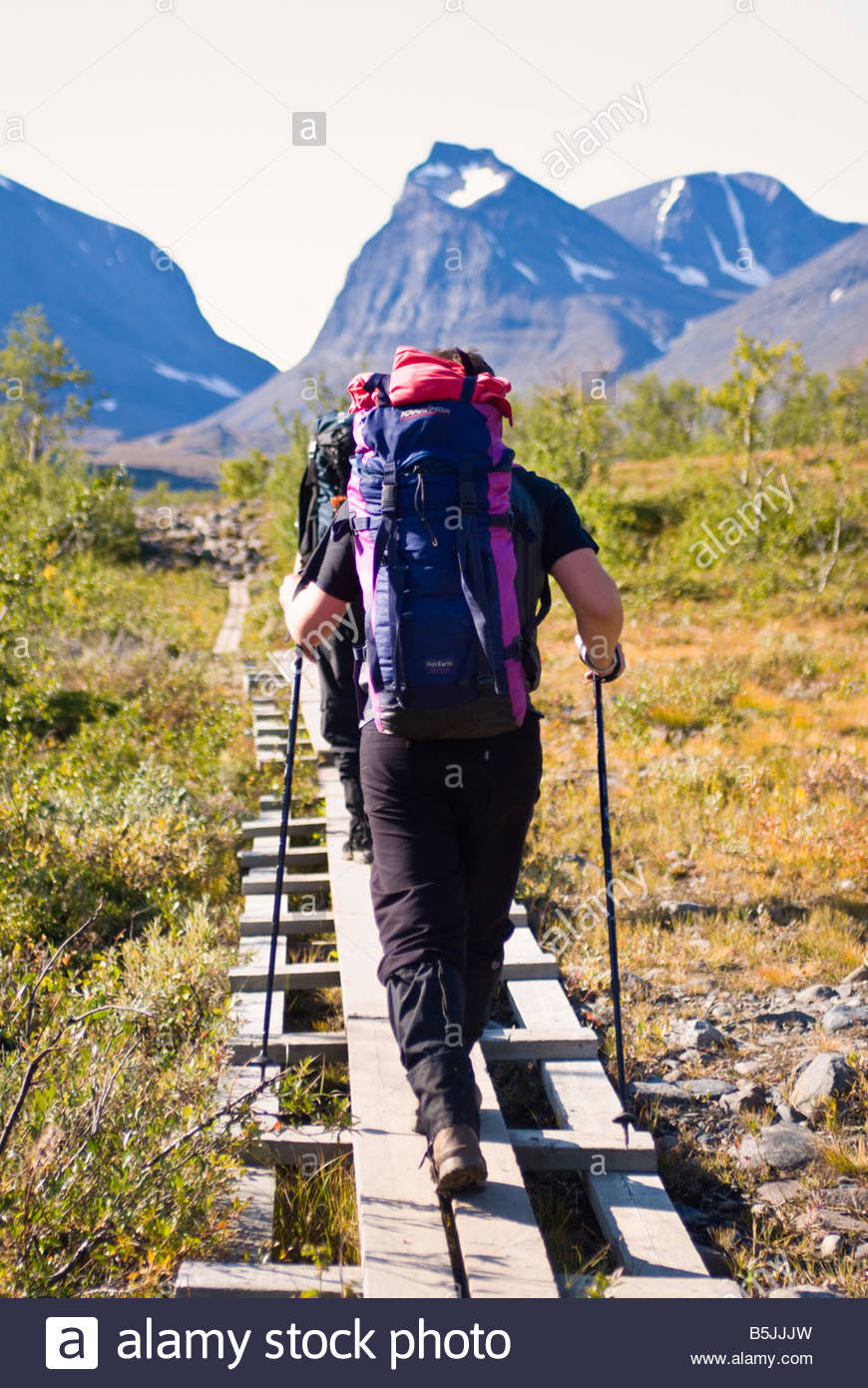 Hiking the arctic wilderness, en route to Kebnekaise, Sweden's highest mountain. - Stock Image