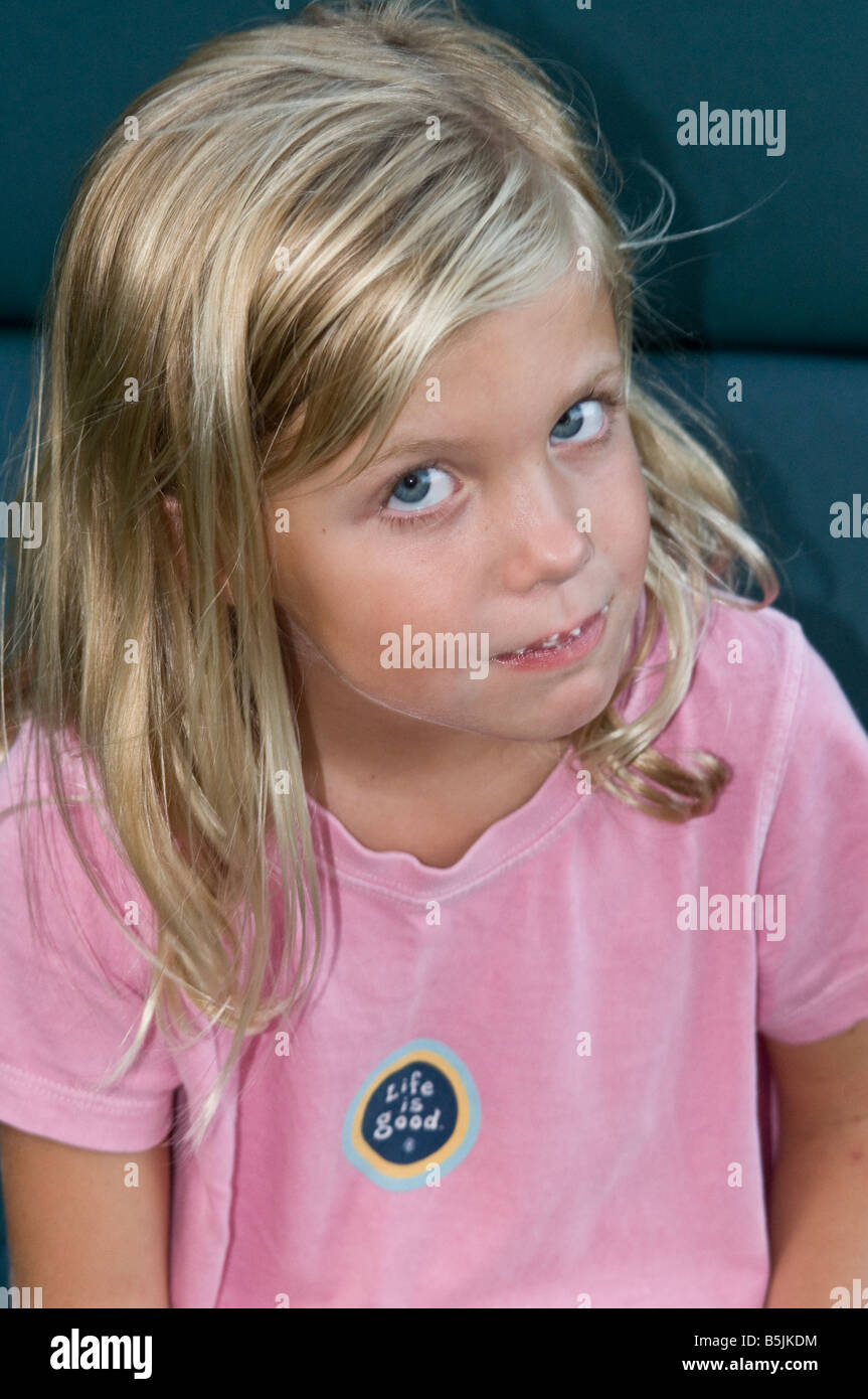 young 6 7 8 year old girl looks curious Stock Photo