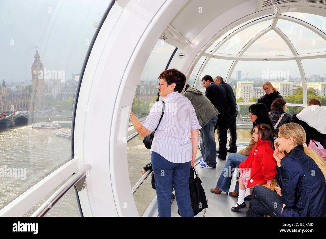 London, UK, United of kingdom, Tourists enjoying the aerial view on river Thames inside London Eye - Stock Image