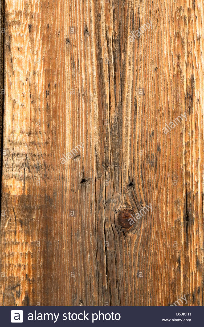 Texture weathered wood boards background aged old shed building vertical - Stock Image